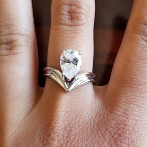 Jewelry - 925 sterling silver ring with cubic z's. Size 8
